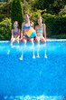 Family in swimming pool on vacation, underwater view