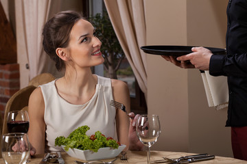 Woman talking with waiter