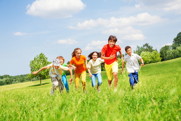 Funny children running in the field