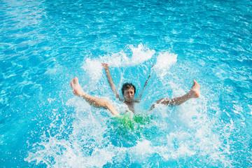 Man falling and splashing into water
