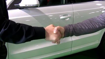 Handshake. White car deal