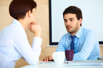 Business People having conversation with colleague during break