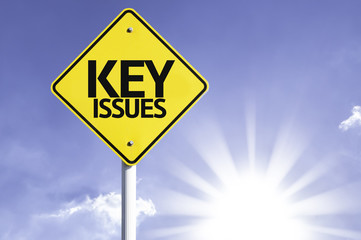 Key Issues road sign with sun background