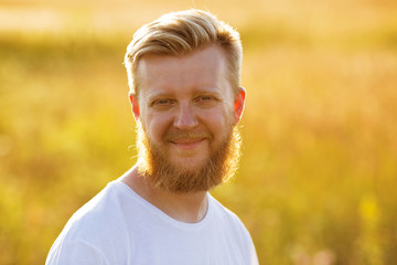 Smiling man with a big red beard