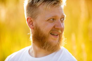 Cheerful blond bearded man in т-shirt