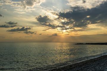 beach stones sunset