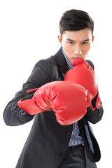 Asian businessman with boxing gloves