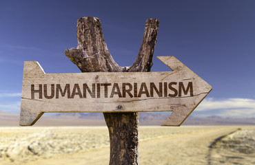 Humanitarianism wooden sign on desert background