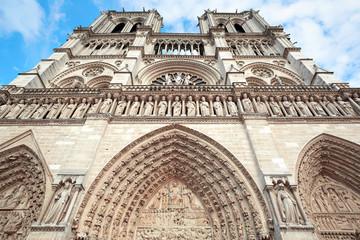 Notre Dame de Paris facade, blue sky