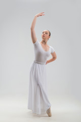Young and beautiful ballet dancer posing isolated