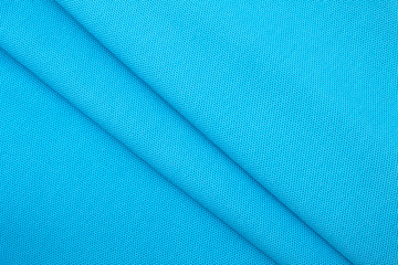 Background of wavy blue cotton fabric