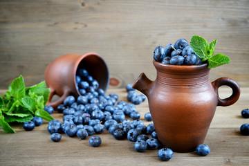 Fresh blueberries in a rustic jug