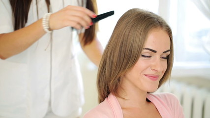 Happy beautiful woman smile to camera in hair salon