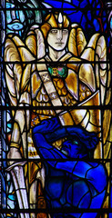 Angel fighting / defeating devil in stained glass