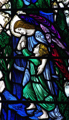 Angel guiding / helping a child in stained glass