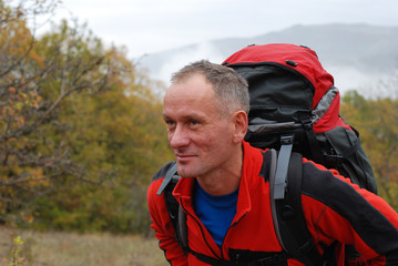 Backpackers in autumn mountains