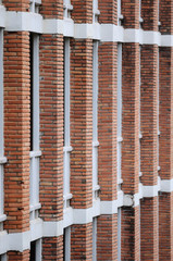 Red brick poles of building for background.
