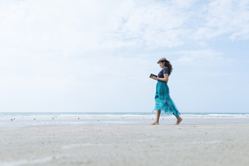 Tablet User Lifestyle On The Beach