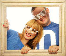 Loving couple in picture frame.