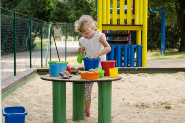 blond child on playground