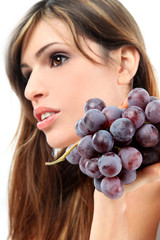Beautiful girl with grapes
