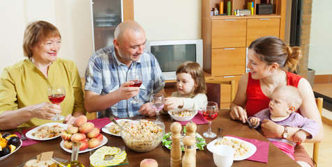 happy multigeneration family  over holiday table