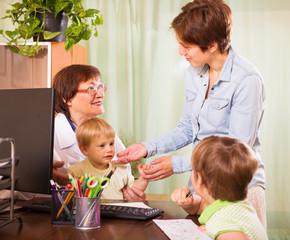 friendly pediatrician doctor examining children