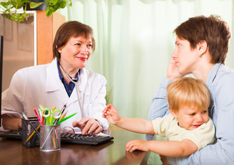 Smiling pediatrician doctor talking with mother