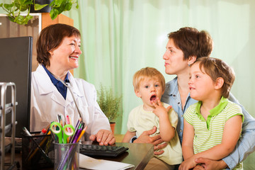 mother of two children  talking with friendly  doctor
