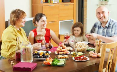 happy multigeneration family  around festive table