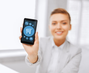 close up of businesswoman with smartphone