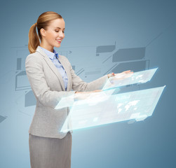 smiling businesswoman working with virtual screens