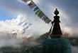 Buddhist Stupa with prayer flags and Thamserku peak