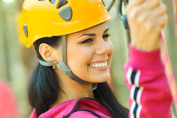 attractive girl in a special outfit engaged in climbing.