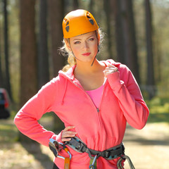 Portrait of attractive sporty girl in climbing gear