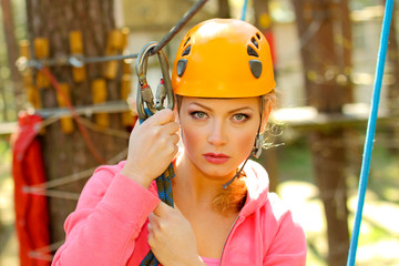 Portrait of a frightened girl who is engaged in rock climbing