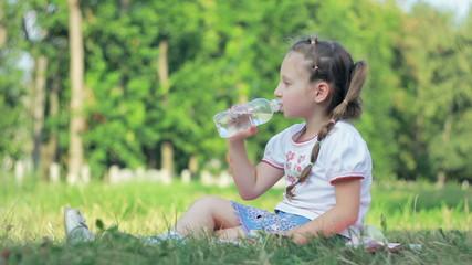Girl drink water from bottle