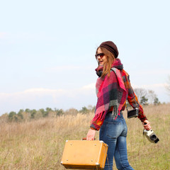 modern girl travels to wildlife with vintage camera
