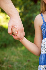 father holding  daughter hand