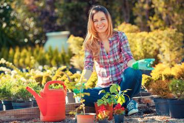 Woman in garden planting flowers