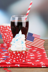 American patriotic holiday cupcake and glass of cola