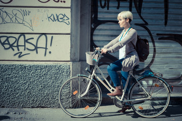 beautiful young blonde short hair hipster woman with bike