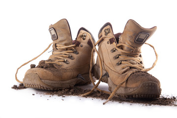 an old boots covered with soil
