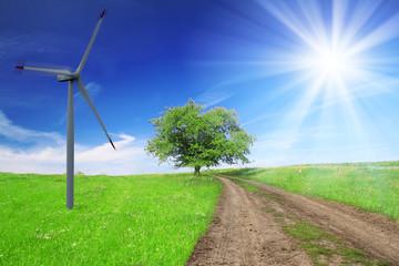 Field,tree,blue sky with wind turbine