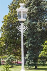 Ornate old street light in gardens
