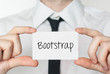 Bootstrap. Businessman holding business card