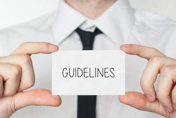 Guidelines. Businessman holding business card