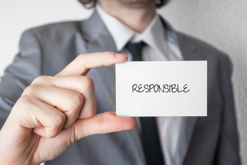 Responsible. Businessman showing business card