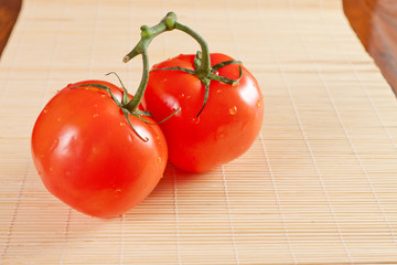 branch of ripe red cherry tomatoes