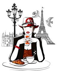 Paris - woman on holiday having breakfast